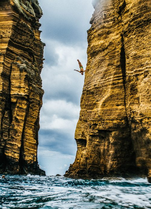 Robin Georges of France dives from a 27 metre cliff face on Islet Vila Franca do Campo during the first training session of the third stop at the Red Bull Cliff Diving World Series in Sao Miguel, Azores, Portugal on July 12, 2018 // Ricardo Nascimento / Red Bull Content Pool // AP-1W8RMMAFW2111 // Usage for editorial use only // Please go to www.redbullcontentpool.com for further information. //